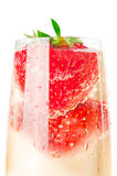 Sparkling wine (champagne) and strawberry Royalty Free Stock Images