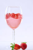 Sparkling wine champagne and strawberry Stock Images