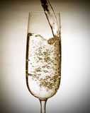 Sparkling wine. Close up of pouring sparkling wine royalty free stock photography