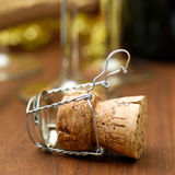 Sparkling wine cork. On wooden ground royalty free stock photography