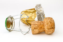 Sparkling wine cork with wire tie and gold foi Stock Photos