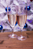 Sparkling wine in front of Christmas tree Stock Photography