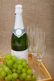 Sparkling wine with grapes and wine glasses Royalty Free Stock Image