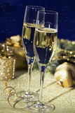 Sparkling wine. Holiday setup with sparkling wine in flute glasses and Christmas decorations royalty free stock photo