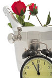 Sparkling wine pail. With roses and alarm clock stock image