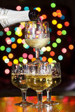 Sparkling wine is poured into the glasses Royalty Free Stock Photos
