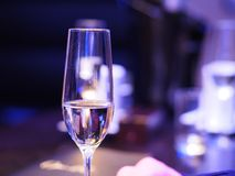 Glass of sparkling wine. With a purple toned background Stock Images