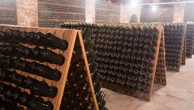 Sparkling wine storing for secondary fermenting in cellar Royalty Free Stock Photography