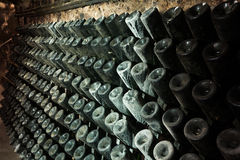 Sparkling wine storing for secondary fermenting in cellar Royalty Free Stock Photo