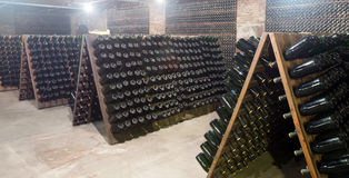 Sparkling wine storing for secondary fermenting in cellar Royalty Free Stock Photos
