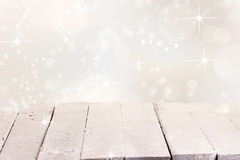 Sparkling winter background for product placement. Sparkling snowy winter or Christmas background for product placement with an empty rustic white painted wooden Stock Photography