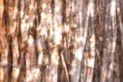 Sparkling Wood Bokeh Background. Bright bokeh sparkle on a blurred wood background royalty free stock photo