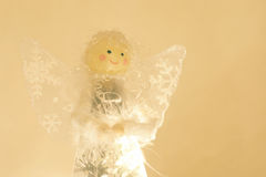 Sparkly angel atop a Christmas tree. A sparkly angel with glittery wings sits atop a Christmas tree Royalty Free Stock Photos