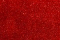 Sparkly błyskotliwość, czerwony tła bokeh skutek zdjęcia stock