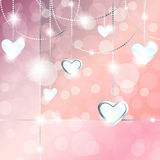 Sparkly banner with heart-shaped pendants. Elegant romance-themed background with gemstone pendants. Graphics are grouped and in several layers for easy editing Stock Images
