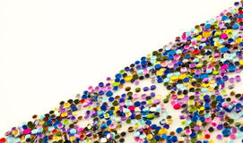 Sparkly beads and glitter. A background of shiny plastic beads and glitter Stock Image
