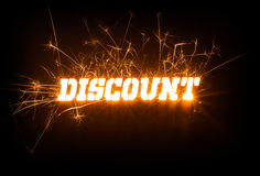 Sparkly blocky DISCOUNT stencil word on dark background. Stock Images