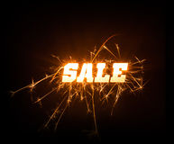 Sparkly blocky Sale word on dark background. A glowing bright SALE word in sparkly design on dark background Royalty Free Stock Image
