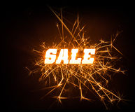 Sparkly blocky Sale word on dark background. A glowing bright SALE word in sparkly design on dark background Royalty Free Stock Images