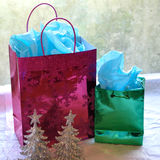 Sparkly Christmas gift bags and trees Stock Photography