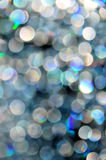 Sparkly circles. Round sparkly circles of light, in blue and white tones Royalty Free Stock Image