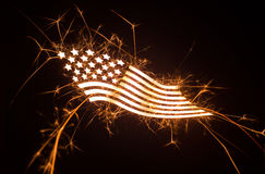 Sparkly curvy flag on dark background Stock Photo