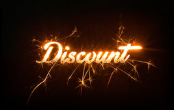 Sparkly DISCOUNT word on dark background. Stock Photography