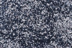 Sparkly glitter. Abstract photograph of sparkly, metallic and reflective glitter card stock photography