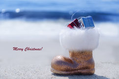 Sparkly glitter boot by the ocean Stock Photo