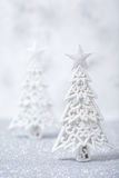 Sparkly glitter Christmas trees in silver and white. Royalty Free Stock Image