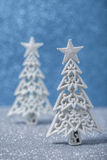 Sparkly glitter Christmas trees in silver and white. Stock Photography