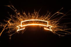 Sparkly glowing ribbon banner with copy space Stock Images