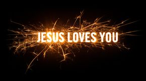 Sparkly glowing title card for Jesus Loves You. Design of sparkly glowing title card for Jesus Loves You on dark background Royalty Free Stock Image