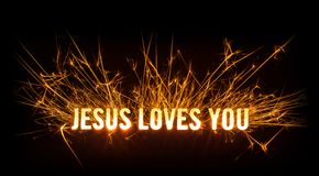 Sparkly glowing title card for Jesus Loves You. Design of sparkly glowing title card for Jesus Loves You on dark background Royalty Free Stock Photography