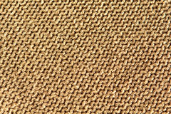 Sparkly gold knitted wool background. Sparkly gold background fabric texture knitted in reverse stocking stitch Stock Photos
