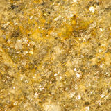 Sparkly Golden Rock Background. Sparkly Golden Rock Textured Background with golden flecks Royalty Free Stock Photography