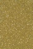Sparkly Goldfunkelnhintergrund Lizenzfreie Stockfotografie