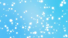 Sparkly particles falling down a blue background stock video