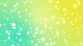 Sparkly particles moving across a teal yellow background stock video footage