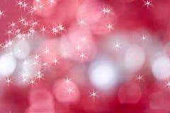 Sparkly roter Hintergrund für Weihnachten Stockbild