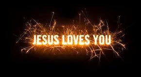 Sparkly rozjarzona tytułowa karta dla Jezus Kocha Ciebie Zdjęcia Royalty Free