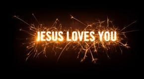 Sparkly rozjarzona tytułowa karta dla Jezus Kocha Ciebie Obrazy Stock