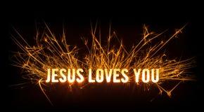 Sparkly rozjarzona tytułowa karta dla Jezus Kocha Ciebie Fotografia Royalty Free