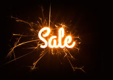 Sparkly Sale word on dark background. Royalty Free Stock Image