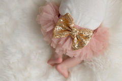 Sparkly Sequin Bow on a Baby Girl`s Bottom Royalty Free Stock Photo