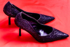 Sparkly shoes. A close up of sparkling black stiletto heel shoes Stock Image