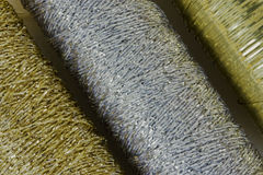 Embroidery threads. A close-up of three sparkly sewing threads Royalty Free Stock Image