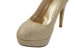 Sparkly toe of a gold fashionable high-heeled shoe Stock Images