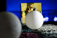 Sparkly White Christmas Balls with Gift in Background. Sparkly White Christmas Balls with Present in Background Stock Photography
