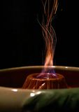 Sparks. Shooting out of a bowl shaped like a volcano royalty free stock images